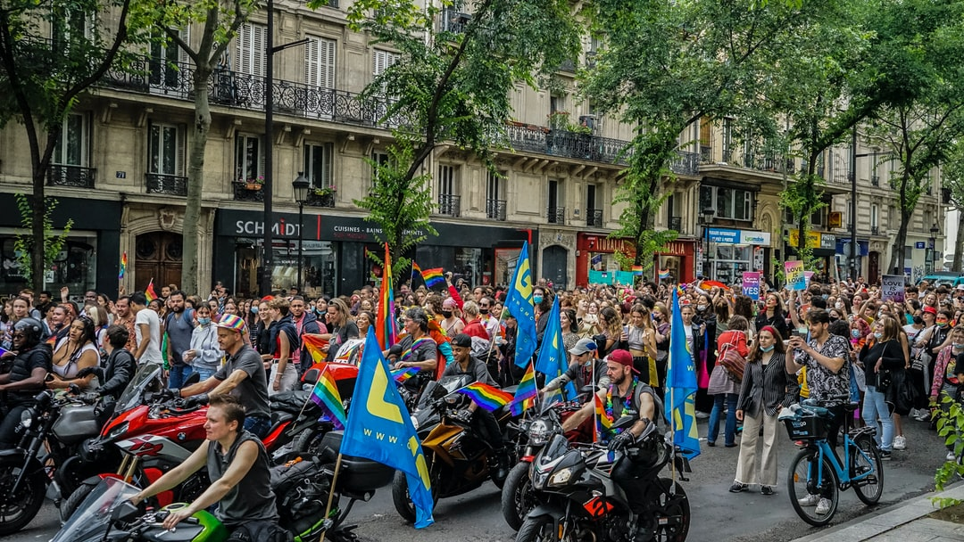 A group of people on a motorcycle in front of La Rambla, Barcelona
